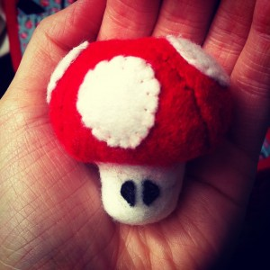 1-UP Pin Cushion - I love video games! And for anyone who even remotely knows the Super Mario series this little guy should be no stranger. I made this guy with felt and simply looking at pictures online of the mushroom (which is what he is called). I can now keep him in my sewing bow to hold all my pins and needles.
