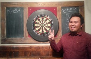 Playing darts with my parents - Dustin's second bullseye!