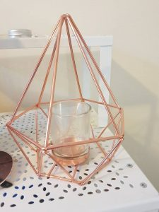 A photo of a copper candle holder