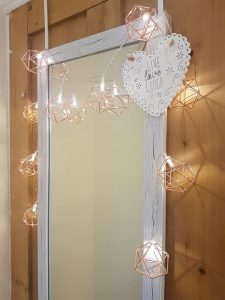 A photo of my mirror with fairy lights around it