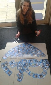 Making a banner with all the postcard to paris pictures!