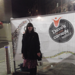 I forgot I had a camera when getting my ticket signed, so here's a picture of me in front of a comedy festival sign.