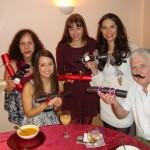 My family and our Christmas crackers (NB.y My dad is wearing a fake moustache!)