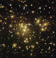 Gravitational lensing is an indicator of the presence of dark matter.Image captured by the Hubble Space Telescope.