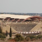 Kourion Amphitheatre. The modern structure behind it protects the Complex of Eustolios from the elements.