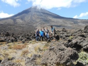 TEAM PHOTO! This was the first glimpse we got of the volcano. 2km down, 8km to the base and the 2km... and then all the way back again!