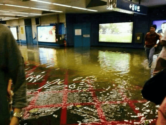 Flooded train station in nearby Kowloon