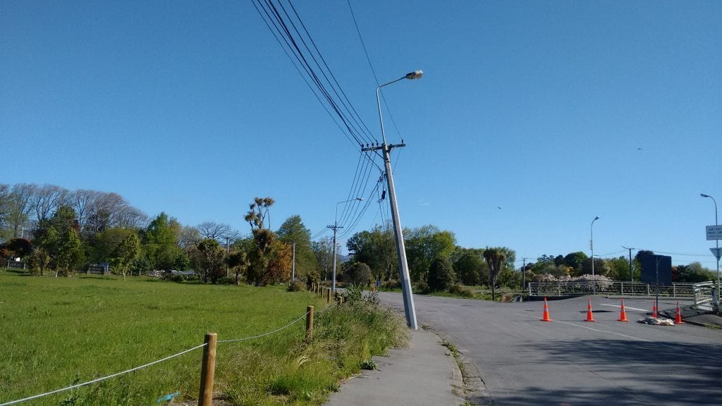 Telegraph poles bent as a result of the liquefaction