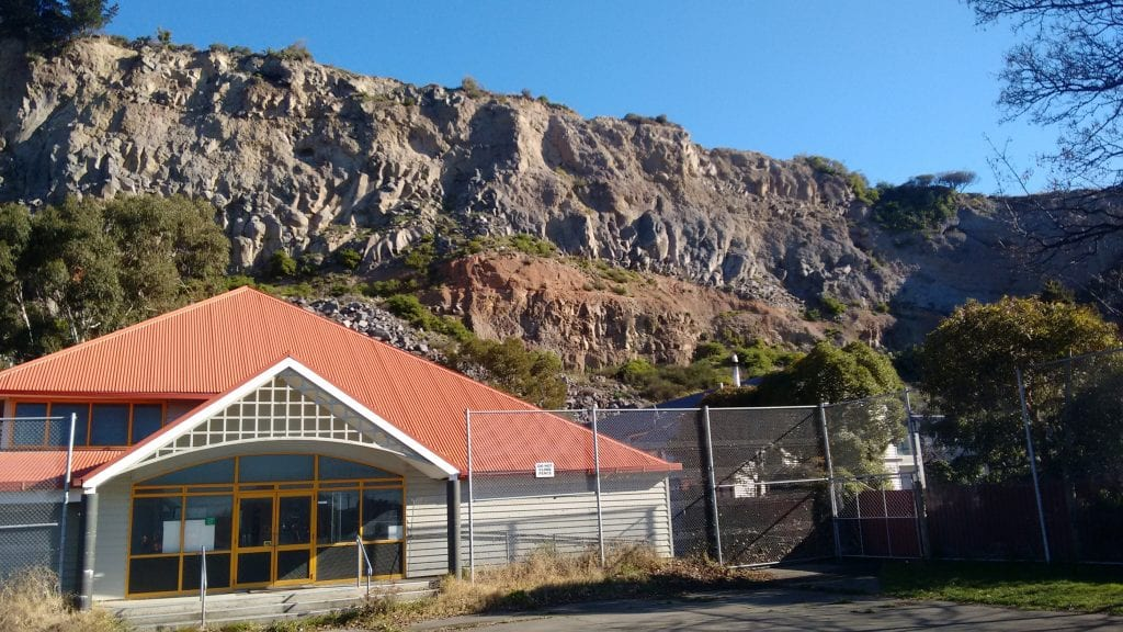 A school abandoned due to rockfall from the cliffs behind