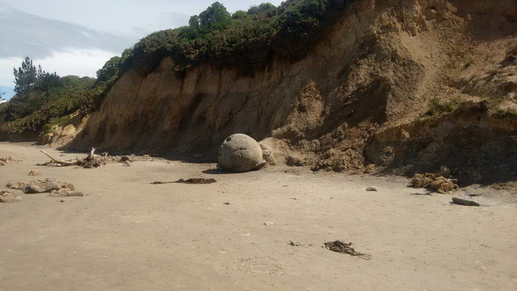 Erosion causes the boulders to emerge from the softer cliffs