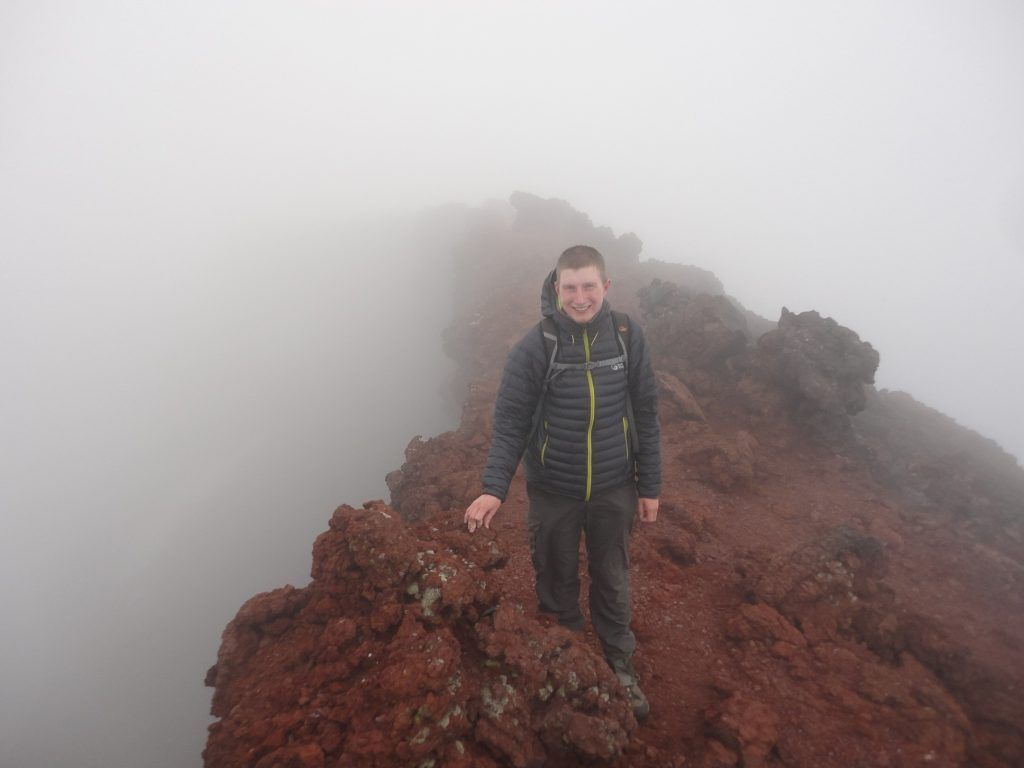 Standing on the edge of the crater, slightly disappointed about the lack of a view