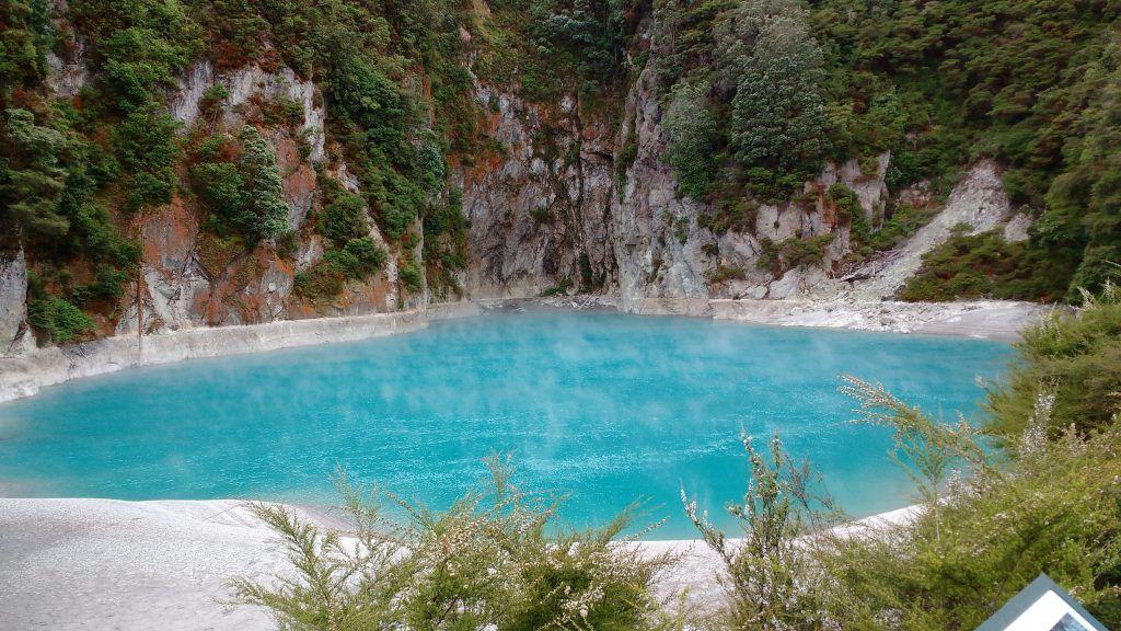 The striking blue lake of Waimangu's Inferno Crater