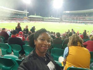 A picture of me sitting in the stands at the AFL match